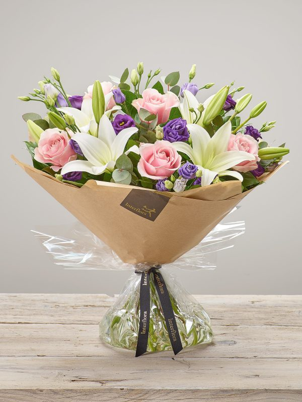 'Dreamy Damson' hand-tied fresh flower bouquet. Includes large headed pink roses, white LA lilies and purple lisianthus