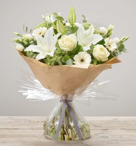'White Radiance' fresh flower arrangement. Includes ivory large headed roses, white germini, white ammi, white oriental lilies and white lisianthus.