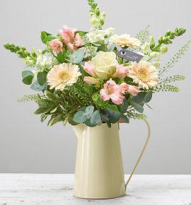 Daydream Believer - Vanilla flower bouquet arranged in a cream zinc jug featuring pink alstroemeria, white antirrhinum, an ivory large headed rose, cream germini, thlaspi, eucalyptus and pittosporum. (Code: C14281MS)