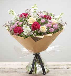 'Pomegranate Punch' fresh flower bouquet - Cream large headed roses, cerise carnations, white stocks, pink spray chrysanthemums and pink limonium. (Code: S33520MS)