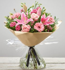 'Pink Radiance' - Hand-tied fresh flower bouquet with oriental pink lilies, pink large-headed roses, pink germinis, pink lisianthus and pink waxflower. (Code: C00350PS)