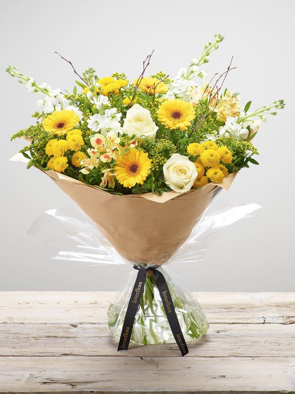 Large 'Lemon Drizzle' hand-tied flower arrangement - featuring white stocks, ivory large headed roses, yellow germini, yellow spray chrysanthemums, lemon alstroemeria and yellow solidago. (Code: S33242MS)