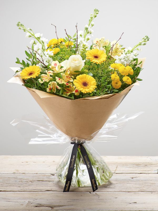 Bernard Chapman hand-tied fresh flower bouquet - 'Lemon Drizzle'. Featuring white stocks, ivory large headed roses, yellow germini, yellow spray chrysanthemums, lemon alstroemeria and yellow solidago with pistache, salal and birch. (Code: S33240MS)