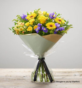 'Sunshine Memories' hand-tied yellow flower bouquet - Featuring yellow large headed roses, yellow spray roses, lemon alstroemeria, yellow germini, blue iris and yellow solidago. (Code: M53500MO)