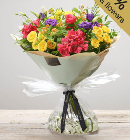 'Very Vibrant' Hand-tied flower arrangement - Featuring a cerise large headed rose, cerise alstroemeria, orange asclepia, purple lisianthus and yellow spray roses with pistache, hand-tied. (Code: M53520MO)