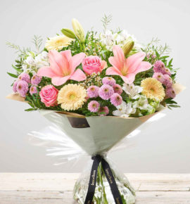 Large Mother's Day Pastels hand-tied floral gift arrangement - Featuring Pink large headed roses, pink LA lilies, white alstroemeria, pink spray chrysanthemums, cream germini and white waxflower with pistache, hand-tied. (Code: M53292MS)