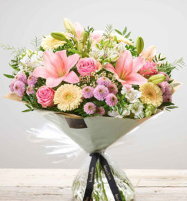 Perfect gift for Mother's Day - Extra Large 'Pastels' hand-tied, fresh flower arrangement. Pink large headed roses, pink LA lilies, white alstroemeria, pink spray chrysanthemums, cream germini and white waxflower. (Code: M53293MS)