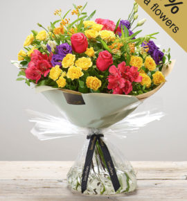 Large 'Very Vibrant' Hand-tied flower bouquet at Bernard Chapman florists - Featuring a cerise large headed rose, cerise alstroemeria, orange asclepia, purple lisianthus and yellow spray roses with pistache, hand-tied. (Code: M53520MO)
